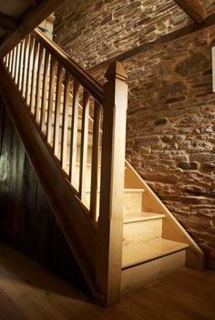 Handmade English oak staircase with carved stair brackets.