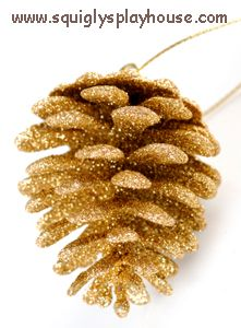 Kid's Crafts: Make glitter pine cone decorations.