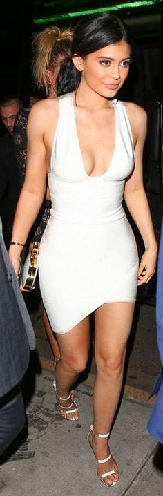 Kendall Jenner: shoes – Tamara Mellon  Purse – Giuseppe Zanotti  Bracelet – Cartier  Dress – House of CB