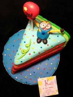 Mini Cake that looks like a big cut slice of cake with a little Minion & Balloon on top.