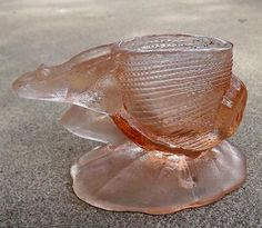1920s pink glass figural toothpick holder frog dragging shell - charity for animals via Etsy