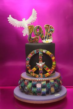 Other Cakes - Retro Birthday Cake. Word LOVE and Peace symbol made of Pastillage paste and hand painted. The decoration of the bottom cake and dove are made on rice paper