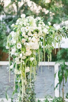 STUNNING white flowers and greenery covered the chuppah at this luxury Santa Monica wedding. Flowers by Lilla Bello White Floral Arrangements, Wedding Arrangements, Wedding Centerpieces, Wedding Decorations, Pergola Decorations, Floral Centerpieces, Wedding Flower Guide, Floral Wedding, Wedding Ideas
