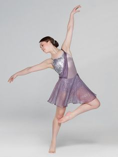 NEW! 2017 Collection Contemporary & Lyrical Costumes: Satin spandex leotard with extended bike-shorts leg line and an overlay of sequin mesh has satin elastic shoulder straps and a chiffon sash. Attached skirt is layers of chiffon.  Includes hair clip, hanger and garment bag.