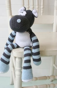 Knit toy for baby or child's birthday gift in blue and gray.