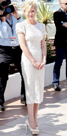 Look of the Day › May 23, 2012 WHAT SHE WORE Dunst greeted fans at a Cannes press event for On The Road in a textured Dolce & Gabbana LWD, Van Cleef & Arpels watch and platform heels from Charlotte Olympia.