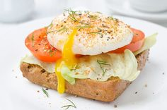Looking for a delicious way to serve poached eggs? Serve them on toasted bread with lettuce and tomato for an easy breakfast or brunch. The creamy runny egg yolks taste yummy with crisp lettuce and juicy tomato slices. Enjoy!