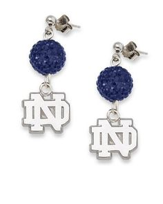 NCAA Notre Dame Fighting Irish LogoArt Ovation Earrings by Logo Art. $39.99. Give yourself the ovation you deserve for being so devoted to your team by wearing these LogoArt® Ovation earrings.  Your team's logo expertly crafted in solid sterling silver and richly plated in a rhodium finish, dangles from a sphere glistening with an array of pavé crystals that match your team's colors.  Ball post earrings with push backs.