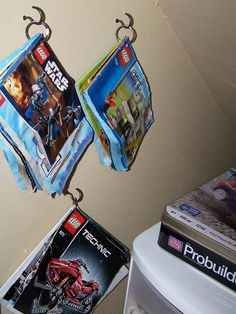 Delightful Order: Storing Children's Toys - Part 3 - I love this idea for storing Lego construction manuals!