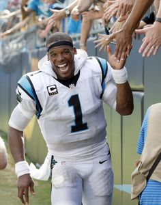 Carolina Panthers' Cam Newton (1) celebrates after an NFL football game San Francisco 49ers in Charlotte, N.C., Sunday, Sept. 18, 2016. (AP Photo/Bob Leverone)