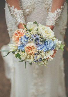 White Garden Roses, White Astilbe, White Sweet Pea, Silver Brunia, Peach Juliet English Garden Roses, Blue Hydrangea + Greenery