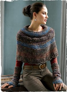 Our cozy capelet is knit of tweeded bouclé yarns in a gradation of moorland hues; alpaca (85%), pima (8%), wool (5%), silk (1%) and nylon (1%).