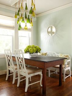 Sometimes just one decorative element is all you need to make a wall pop. This sunburst mirror is simple yet elegant, and is just in tune with the clean, white feel of the kitchen. Dining Room Design, Dining Room Chairs, Dining Room Furniture, Dining Table, Dining Rooms, Furniture Ideas, Bright Kitchens, Home Kitchens, Living Room Update