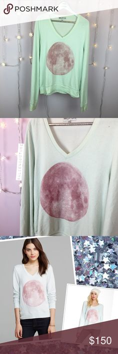 Wildfox Pink Moon Jumper Gorgeous mint v-neck Wildfox Baggy Beach Jumper with a stunning pink full moon graphic. This BBJ is such a beautiful piece of Wildfox. Super soft and comfy! Crafted from the signature WF prepilled jumper material we all know and love. Never worn because it is too big on me. Perfect condition. Not in any hurry to part with this beauty. Looking to sell or very selectively trade for another moon piece in a size XS or S.🌕 Wildfox Tops Sweatshirts & Hoodies