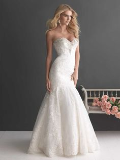 Style 2667 This gorgeous fit and flare shaped gown has a fitted bodice with a sweetheart neckline embellished with Swarovski crystals. The entire design is adorned with delicate lace appliqué on English net.