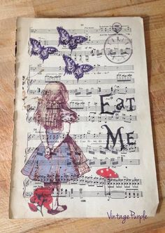 Alice in Wonderland Eat Me print. Measurements - 17 cm x 24.5 cm  Designed by myself using original Alice in Wonderland images and printed onto a vintage music sheet.  The perfect gift for an Alice fan.  You could frame it, add it to a journal or just stare at it! Stunning!  Please note - Each music sheet will be different, also please allow for natural wear and discolouration as the sheets are very old