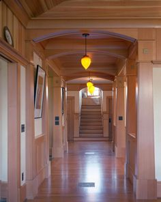 stunning hallway with traditional craftsman woodwork and columns