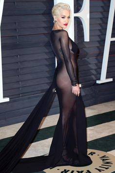 Pin for Later: 25 Looks From Last Year's Oscars That Practically Reinvented the Word Sexy Rita Ora Rita Ora bared her booty in a sheer black Donna Karan dress with a long train at the Vanity Fair afterparty. Beyonce, Rihanna, Natasha Poly, Elsa Hosk, Emily Ratajkowski, Irina Shayk, Alessandra Ambrosio, Halle Berry, Oscar Dresses