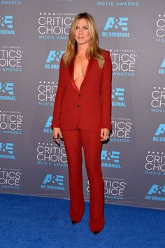 "She loves the '90s: Jennifer Aniston, whose long-running sitcom, ""Friends,"" was recently released on Netflix in its entirety, wears a paprika-colored low-cut Gucci pantsuit reminiscent of one worn by Gwyneth Paltrow in the brand's Tom Ford era at the Critics' Choice Movie Awards."