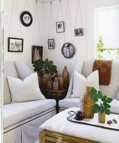 wonderful use of the corner - hanging frames and object covered side table