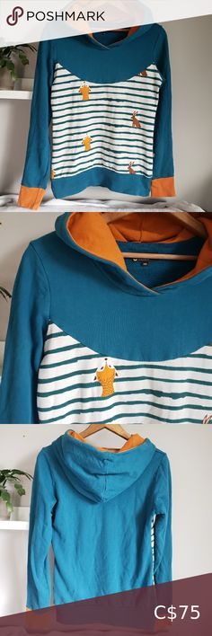 Bonnie & Buttermilk Fox and Rabbit Pullover Hoodie From German indie sustainable slow fashion brand Bonnie & Buttermilk, this adorable and unique pullover hoodie sweatshirt! Teal blue with rust orange cuffs and hood lining, and whimsical front accent fabric in stripes with fox and bunny rabbit print. Cotton with a touch of spandex for a comfortable fit. Made in Berlin, Germany. Size is 36, which fits like a small. Bonnie & Buttermilk Tops Sweatshirts & Hoodies Long Hoodie, Sweater Hoodie, Pullover, Nasa Hoodie, Blue Pencil Skirts, Rust Orange, Under Armour Hoodie, Grey Zip Ups, Leather Blazer