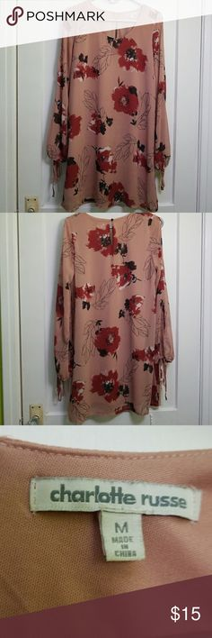 Charlotte russe pink floral dress Long sleeved short pink floral dress. Gently used but still in good condition. Charlotte Russe Dresses Mini