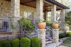 Similiar Country Style Porches With Stone Columns Keywords.  Tall planters near entrance.