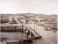 1873, Yokohama. Bentenbashi (Benten Bridge) and Yokohama station. The train tracks are hidden behind the buildings, but some freight cars are visible on the shunting yard on the right. The hill in the background is Nogeyama, location of Iseyama Kotaijingu, a shinto shrine, and Noge Fudo, a buddhist temple. At the time, Nogeyama was a popular residential area for wealthy merchants. The station was the starting point for the railroad connection to Tokyo.