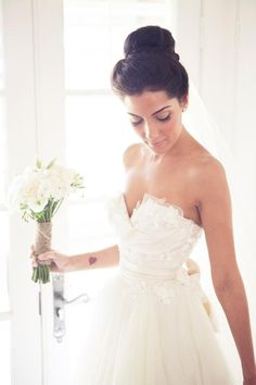 I don't usually like strapless wedding dresses but this one is gorgeous with the overlay -- and the bouquet!!