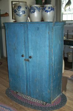 19th century New York State two door pine  storage Cupboard with wonderful original  dry blue paint    www.mycountrytreasures