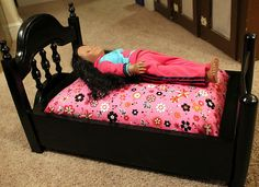 bed for American Girl doll... 2 chair backs, a few 2x4's, & a standard size pillow!
