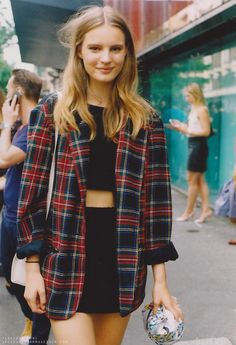 over-sized flannel, black skirt and crop top. Replace the crop top with a longer shirt or a dress and you have a perfect stylish school outfit