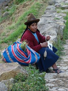with her drop spindle. Peru