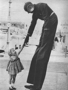Pierrot is a m tall, kg humanoid entity covered entirely in charcoal gray cloth of an unknown material, including a mask which completely obscures its face. Old Photos, Vintage Photos, Nostalgia, Tall Guys, Tall Man, Grey Outfit, Vintage Circus, White Boys, Monster
