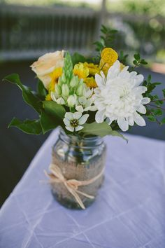 Table Flowers, mason jars covered with burlap, perfect for on top of wine barrels for cocktail hour