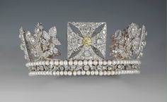 1820     Rundell Bridge & Rundell The Diamond Diadem made for George IV, openwork silver frame lined w gold, set transparent w 1,333 diamonds including a 4 carat pale yellow brilliant in the centre front cross. It has been worn regularly by queens regnant and consort from Queen Adelaide onwards since George IV's use in 1821. Her Majesty now wears it when travelling to and from the State Opening of Parliament