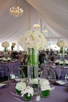 Small posies and votive around a bigger centerpiece  Luxurious Wedding by M. Elizabeth Events