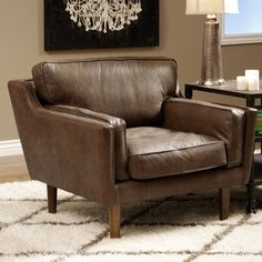 Add a Danish retro design element to your living room with the Beatnik chair, featuring an Italian semi-aniline leather upholstery in an Oxford Tan color. This chair also highlights a poplar and pine wood frame with oak stained legs.