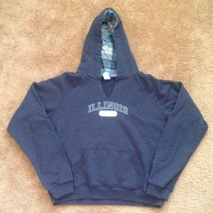 University of Illinois hoodie Cute navy blue hoodie with front pocket. Inside of hood has adorable flannel lining with blue/grey plaid pattern. No drawstring on hood and V cut at neck (came this way). No trades, no PayPal. Tops Sweatshirts & Hoodies