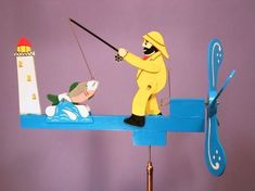 A fisherman catches a great pink and silver salmon in this garden art whirligig wind toy. Scrap Wood Projects, Projects To Try, Fish Tank Coffee Table, Wood Yard Art, Making Wooden Toys, Wind Spinners, Kids Board, Wooden Crates, Wood Patterns