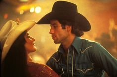Urban Cowboy.That movie taught that hanging out in bars is not good for marriages.  And the dancing was good too.