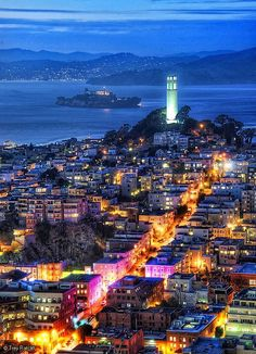 Coit Tower, San Francisco bay, California USA, with infamous Alcatraz (The Rock) in back drop.