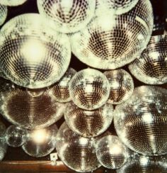 This is an image of disco balls. Disco and Disco balls were super popular in the and into the as well. Popular disco bands were the Bee Gees and Earth, Wind, and Fire. Roller Disco, New Years Eve Decorations, New Retro Wave, Disco Party, Disco Disco, Disco Funk, Disco Theme, 1970s Disco, Prom Party