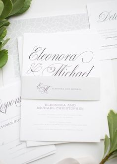 Romantic Wedding Invitations in Gray with Floral Accents and Calligraphy