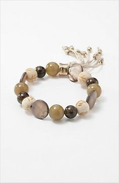 "shell & beads stretch bracelet $29 Freshwater shell, bone and zinc beads on a gel cord with a cotton tassel. Stretches to fit wrists up to 8 1/2""."