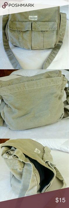 "Cool Canvas Satchel Vintage Bongo. Super clean inside and out!! Measurements, 14""W x 13"" L x 5""D. Adjustable strap is 23"" (46"" end to end). Zippered main, 2 Velcro pouches, 2 nylon zippered smaller pouches. Outside pockets. I see one small dark spot on the bottom, see pic 4. I have many more pics just ask!! This would be great for hiking, an overnighter, beaching, diapering....This is a great size!! The color looks like a drabish green. Vintage Bongo Bags Crossbody Bags"