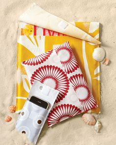 beach cover-ups - made with oilcloth.  These would be perfect to throw into a bigger bag and be able to find that book again…  ;)
