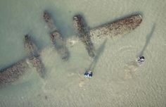 The Wreckage of a USAF Lockheed P38 Lightning Aircraft found buried in sand.  A charity has announced plans to retrieve the wreckage of a rare World War II fighter plane buried under sand and waves on a UK beach.