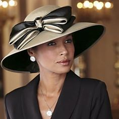 87d52634 An elegant, shimmering work of art…limestone satin is wrapped with a grand  black and limestone bow for this sophisticated hat. One size fits most.