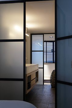 frosted panel glass and metal doors | contemporary bathroom by Baden Baden Interior Amsterdam